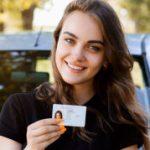 Girl-Holding-License